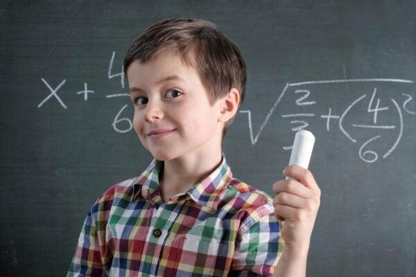 A boy doing Math.