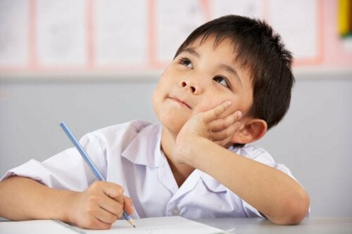 A boy in class thinking.