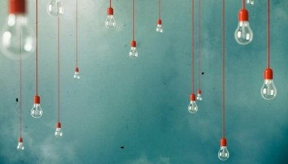 A bunch of lightbulbs hanging from the sky.