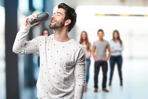 A man drinking an energy drink.