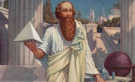 Pythagoras holding a pyramid.