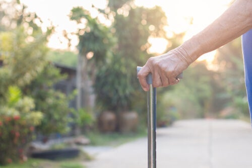 An old person holding a cane.