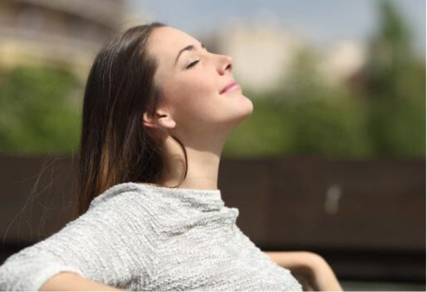 A woman breathing deeply.