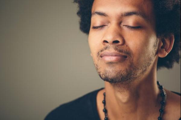 A man breathing deeply.