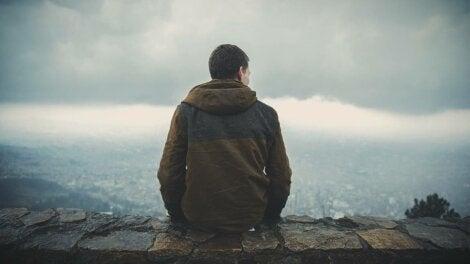A man sitting on a mountain.