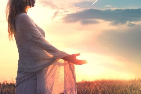 A woman embracing the sunset.