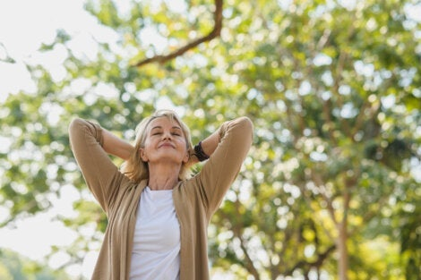An older woman enjoying how nature helps relieve your stress.