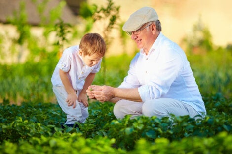 A child and his grandfather enjoy time together outdoors.