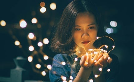 A girl with lights.