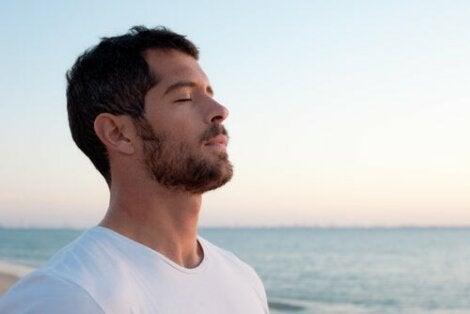 A man breathing.