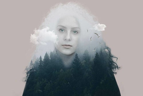 A woman between a forest and clouds.
