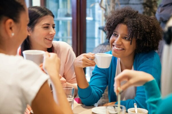 A group of women talking over coffee.