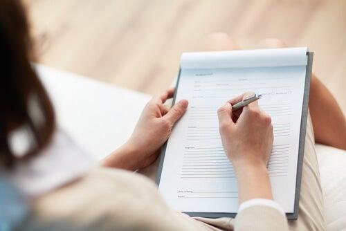 A person filling a form.