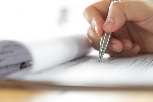 A person writing a social report.