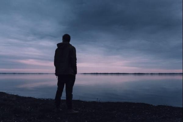 A man standing on a beach.