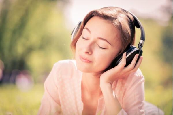 A woman wearing headphones.