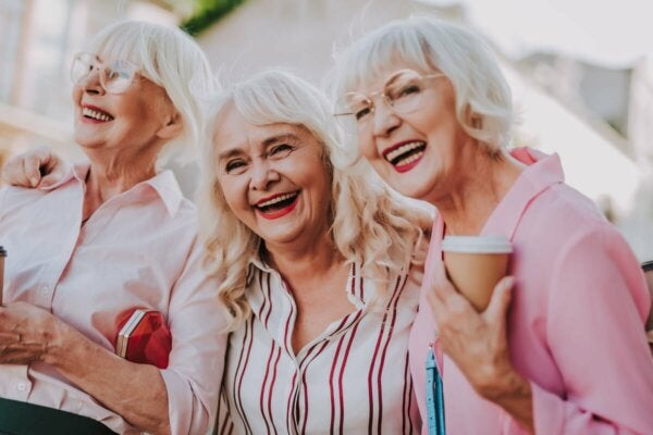Three happy ladies in their sixties.