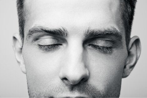 A close up of a guy who is daydreaming.