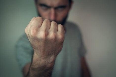 A man exhibiting aggressive behavior.