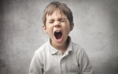 A little boy yelling.