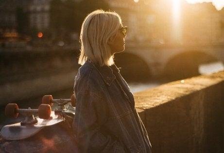 A woman on a bridge.