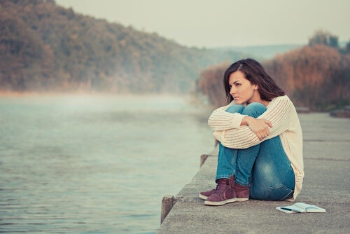A woman thinking, maybe she has an external locus of control.