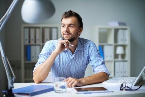 A man thinking at his desk.
