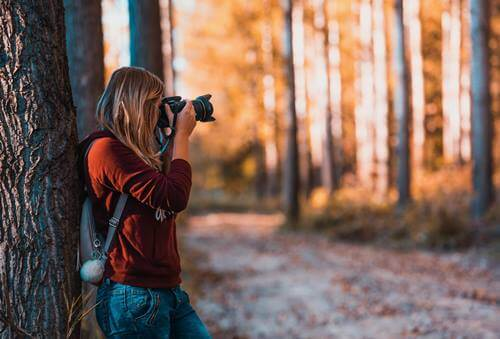 A woman taking pictures.