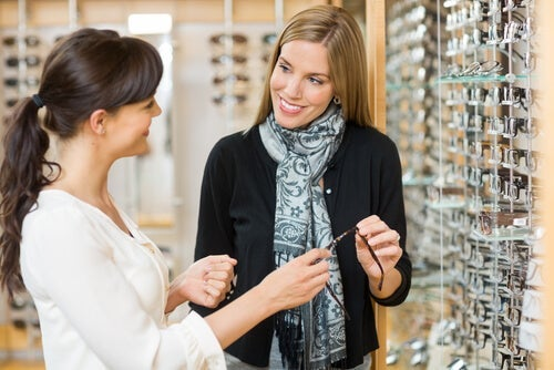 Two women looking at glasses.