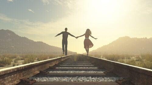 A couple on a rail track.