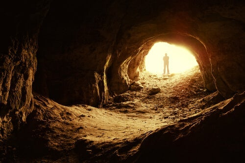 A man in a cave.