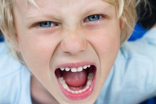 A shouting boy.