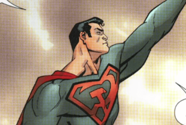 Superman with his arm raised.