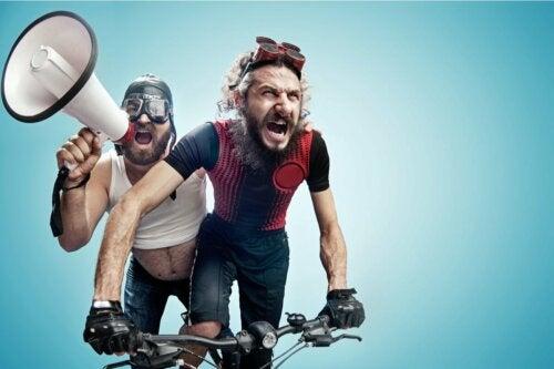Two men riding a bike.