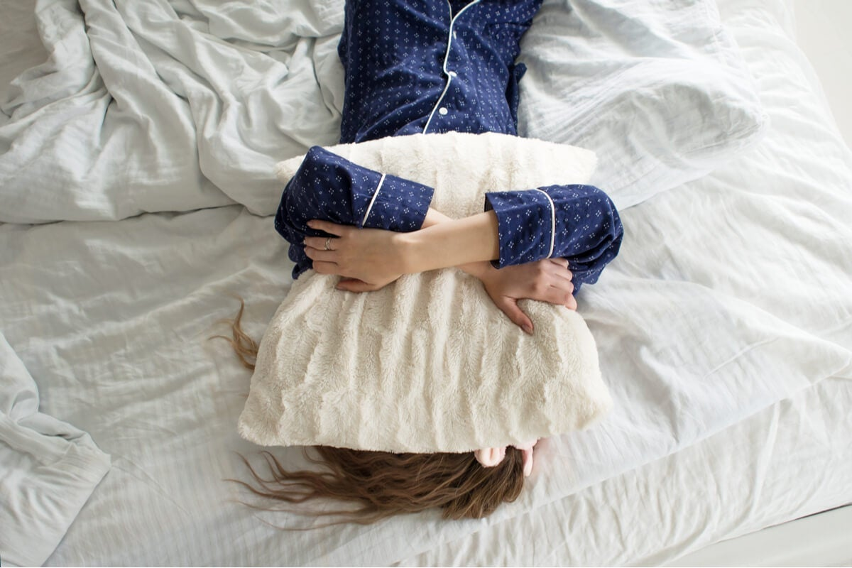A person with a pillow on their face.