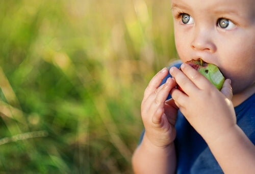 A child eating an apple.