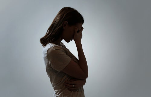 A woman feeling remorse, what Buddhism advises against.