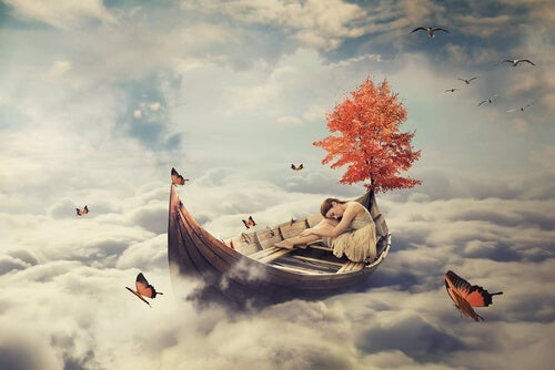 This is a girl sleeping in a boat, contemplating the meaning of dreams.