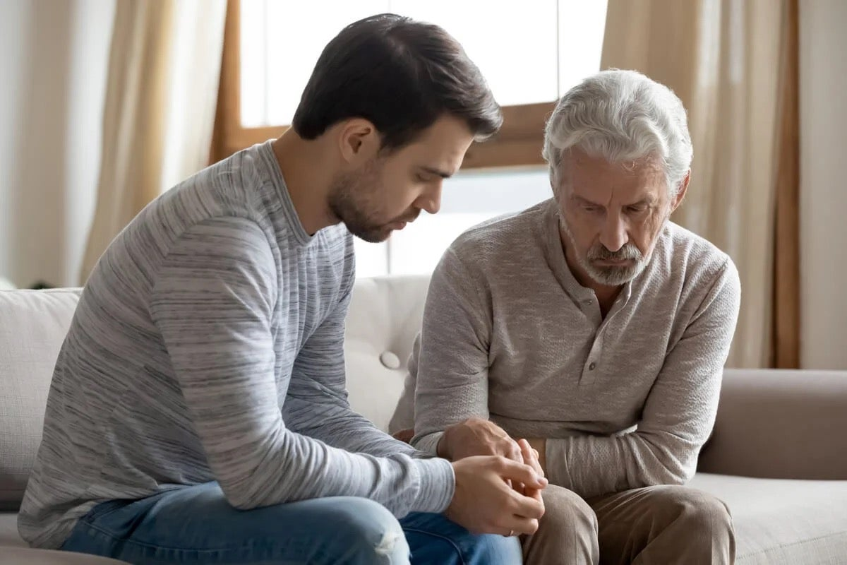 A father and son depicting codependency in the family of an addict.