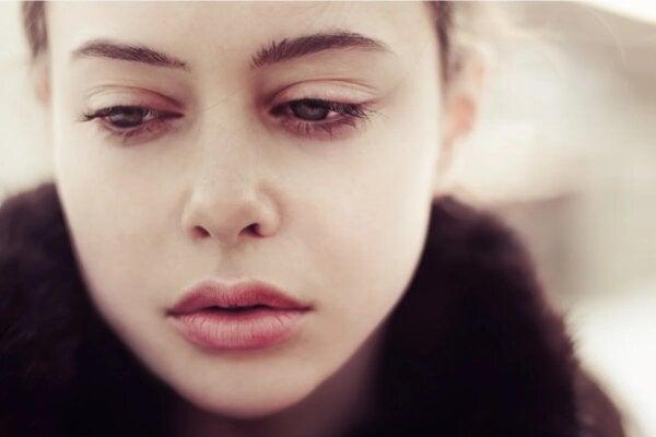 A woman looking sad.