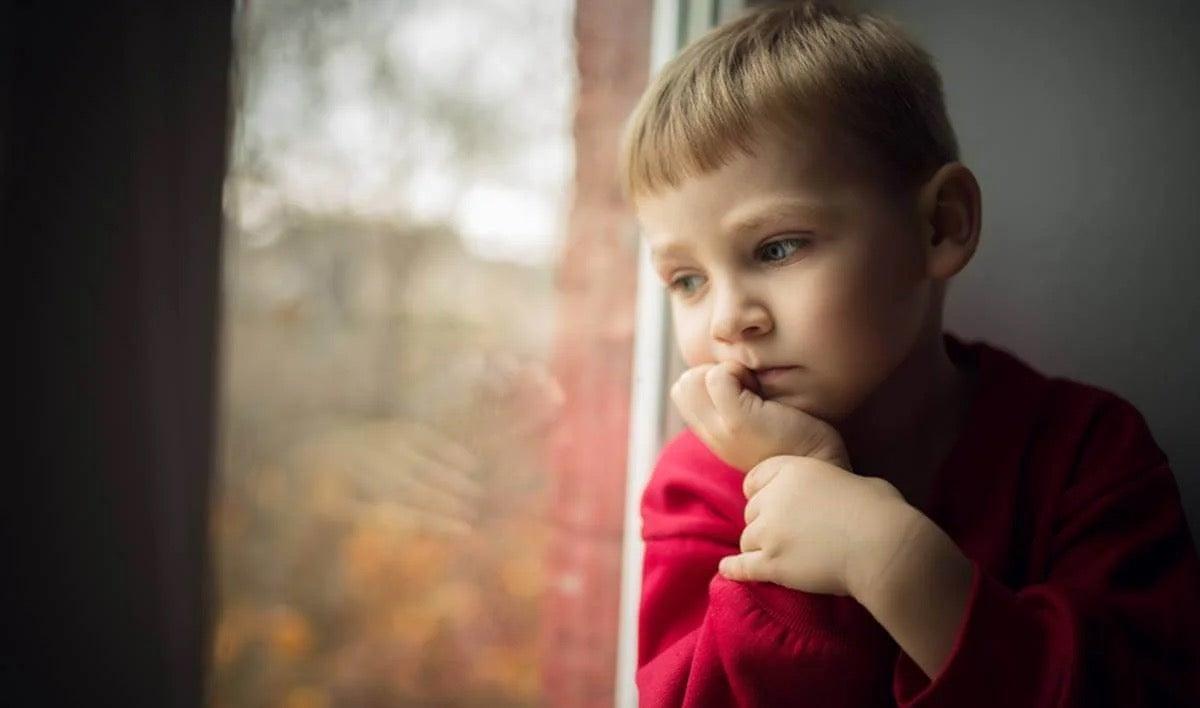 A sad boy, who maybe has gaslighting parents.