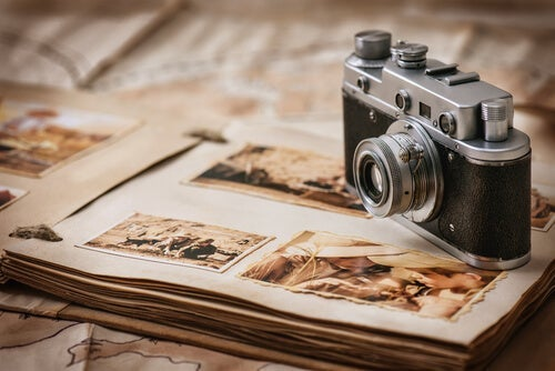 A camera over a photo album.