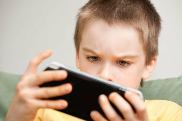 A child looking at a phone.