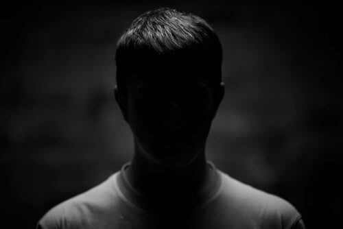 A man in the dark.