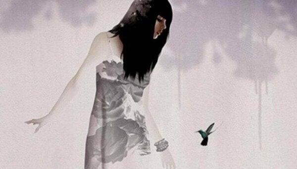 A woman looking at a bird.