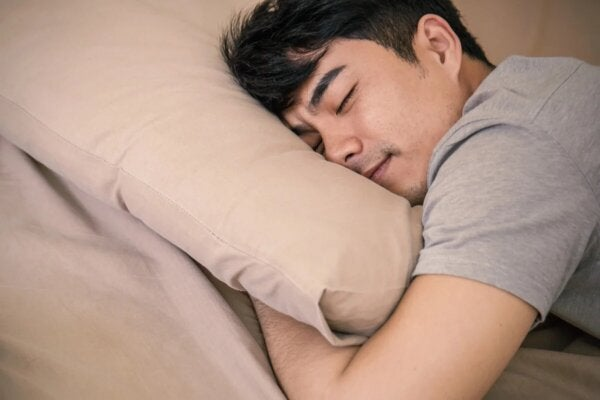 A young man sleeping.