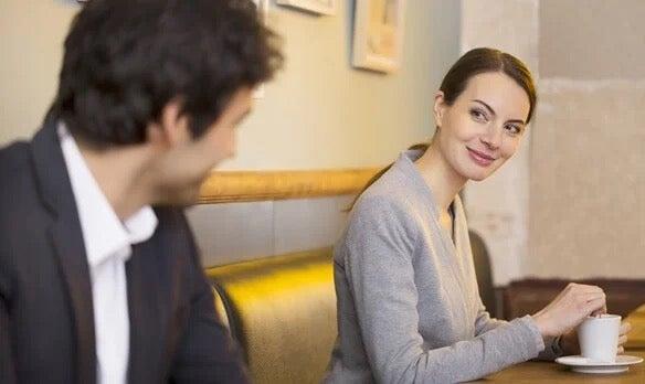 A woman smiling at a man.