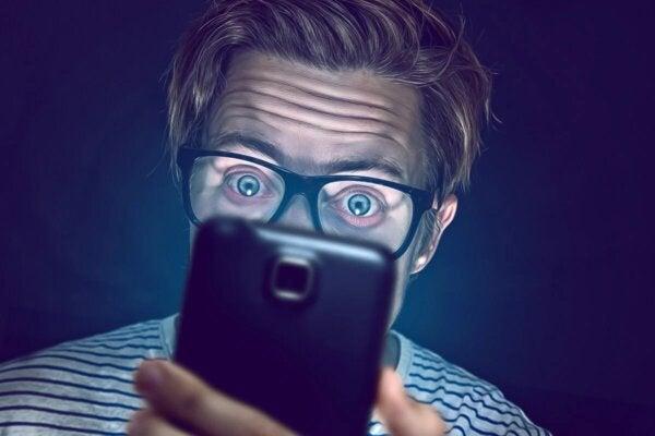 A man looking at his phone.