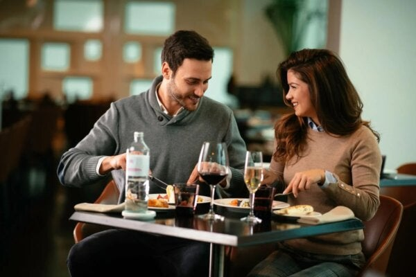A happy couple eating in a restaurant.