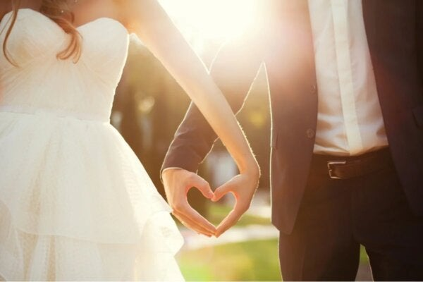 A bride and groom holding hands.